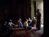 men-discuss-islam-carpeted-floors_12227_600x450