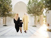 8799981-Muslim-arabic-traditional-oriental-family-walking-together-beautiful-ambient-in-front-of-the-mosque-Stock-Photo